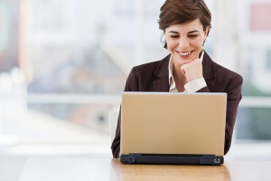Mature businesswoman working on laptop in the office
